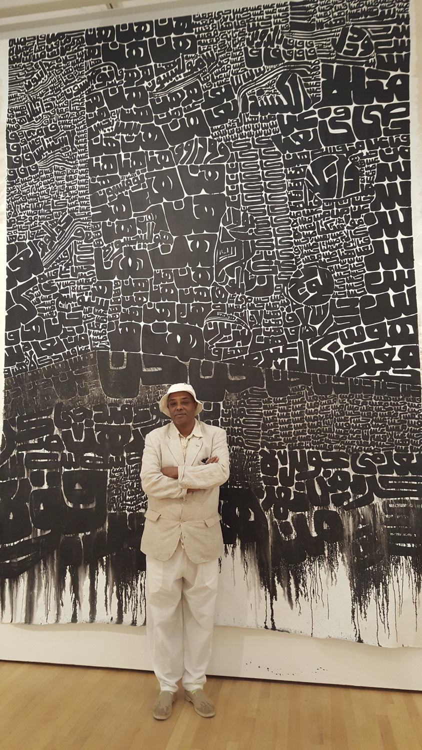 Fathi Hassan in front of Memory (2016)- courtesy of Art Museum of Clark Atlanta University
